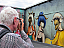 Taking a photo of the Miss Van mural.